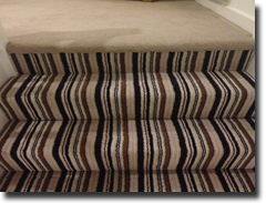 Vogue twist pile stripe carpet and matching plain on landing